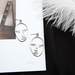 Jewelry - Hollow Face Silver Color earrings
